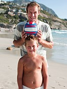 Father and son on a beach with ball