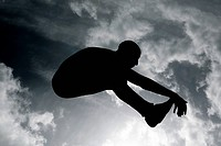 Silhouette of long jumper