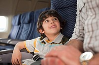 Boy and man on an airplane