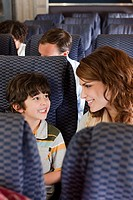 Mother and son on airplane