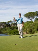 Ecstatic man playing golf