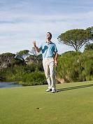 Ecstatic man playing golf