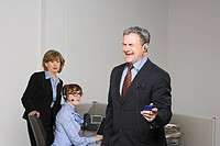 Businessman listening to MP3 player
