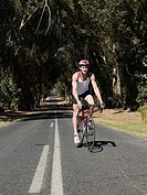 Young man cycling on road