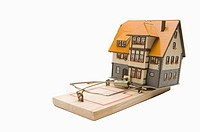 A house model on a mousetrap