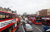 Heavy traffic results in congestion and near standing traffic at Camberwell Green, London SE5