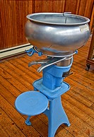 Blue antique cream seperator, sometimes called a creamery which was used to seperator the milk from the cream in past eras Taken inside an old buildin...