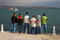 Family by Bosphorus at Kabatas Beyoglu district Istanbul Turkey Europe