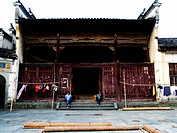 Local people sitting in front of the traditional Hui style ancestral hall , Wuyuan, Jiangxi Province, China