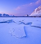 Ice on Haukland beach in winter, Vestvag&#248;y, Lofoten islands, Norway