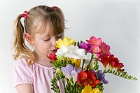 Girl holding Freesia