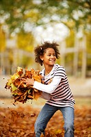 Girl, playing, black, fall foliage, toss up, ,