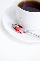 Coffee and heart shaped sweets (thumbnail)