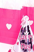 party hat and shopping bags