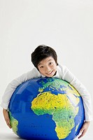 boy holding a globe