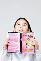 girl holding a book