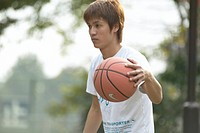 Man dribbling basketball