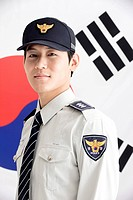 police officer in front of Korean flag, Taegeukgi