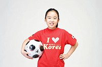 girl holing soccer ball