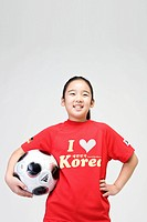 Girl holing soccer ball (thumbnail)