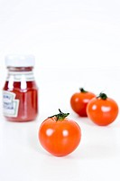bottle of ketchup and cherry tomato