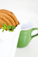 cookies in paper bag and mug