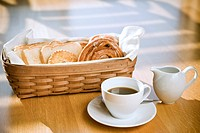 bread in the basket with coffee