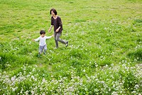 Mother playing with her son in a meadow, Setagaya Ward, Tokyo Prefecture, Japan