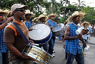 Cuban musicians playing drums during a parade held in Havana Cuba