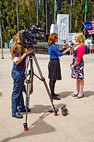 A television news reporter interviews a protester at a 'Tea Party' rally on April 15 Tax Day in Santa Ana, California  Note woman camera operator