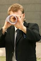 man looking through paper