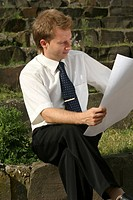 man reading plans