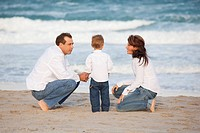 Fort Lauderdale, Florida, United States Of America, A Family On The Beach By The Ocean