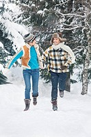Young couple running in snow