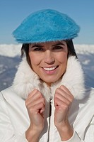 Young woman in winter clothes smiling at camera (thumbnail)