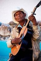 Street musician playing a guitar, San Miguel De Allende, Guanajuato, Mexico