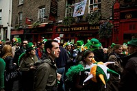 Dublin, Ireland, People Gather In The Street Outside The Temple Bar In Celebration Of Saint Patrick´s Day