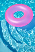 Pink Ring Floating in a Blue Pool