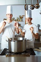 Two chefs satisfied with the results of their culinary skills