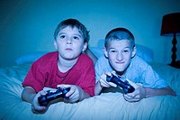 Two boys competing in a video game, Brazil