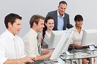 Young multi_ethnic business people and manager working with computers in an office
