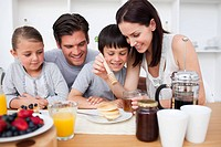 Happy family having breakfast together in the kitchen