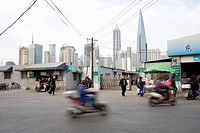 Street in Shanghai, skyline in the background, China