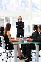 Attractive confident businesswoman smiling at the camera in a meeting
