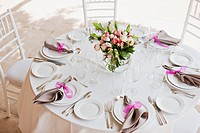 Place setting and centerpiece at wedding reception