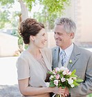 Mature bride and groom smiling (thumbnail)