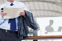 Businessman holding paperwork
