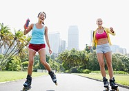 Friends rollerblading in park