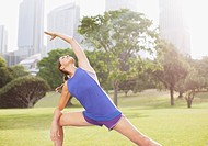 Woman stretching in park before exercise