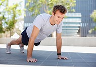 Man doing push_ups in urban setting